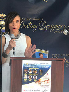 Danielle Douglas, President, Inspire Enterprise, Inc. speaks during the press conference