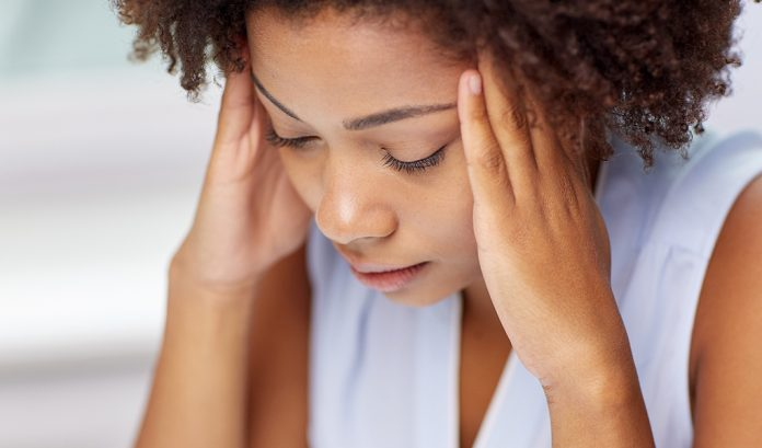 Woman holding her head due to stress