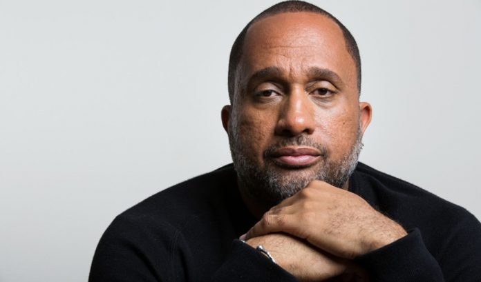 Kenya Barris wearing black top