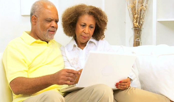 A couple seated drafting up a will