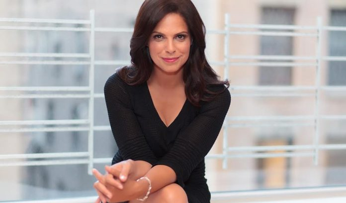 Soledad O'Brien seated