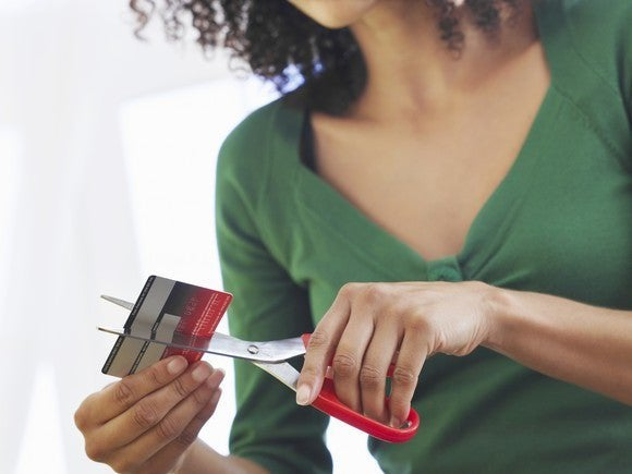 Lady cuts up credit cards