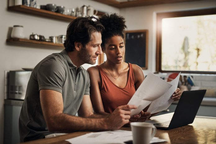 Young couple examining documents