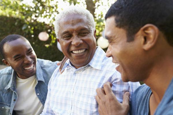 3 Black men smiling outdoors