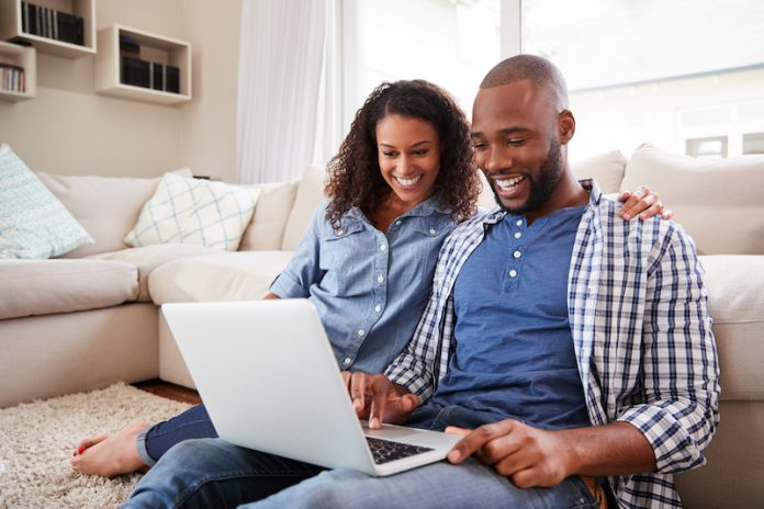 couple looking into a laptop