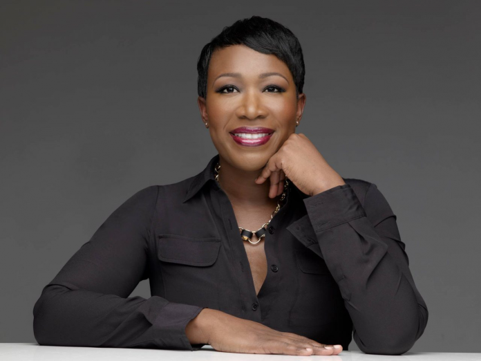 Joy Reid against a gray wall