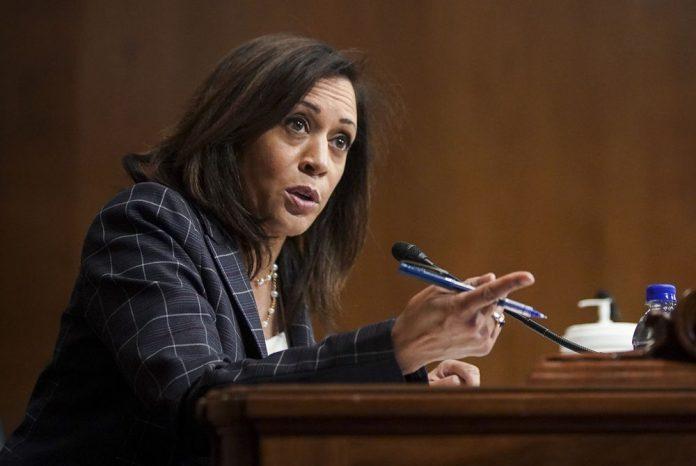 Kamala Harris speaking at a podium