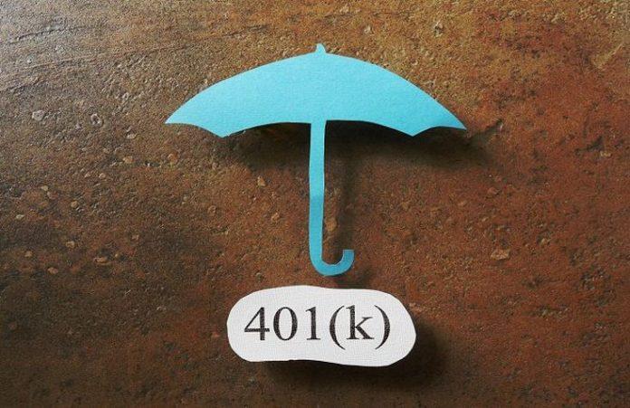 An aqua umbrella against a wood wall