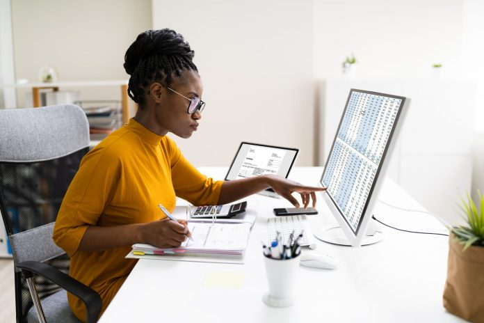 Woman working on desktop computer at a desk