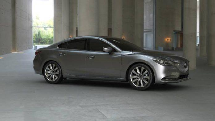 A silver car in a showroom