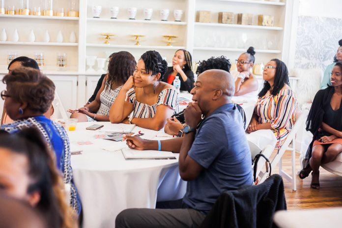 People sitting at tables at an event