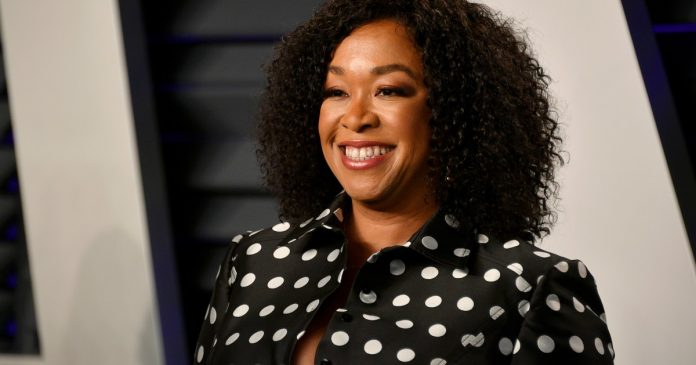Shonda Rhimes smiling at an event