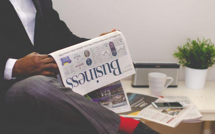 Black man reading newspapeer