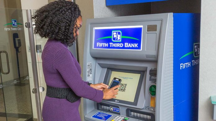 a woman at an ATM