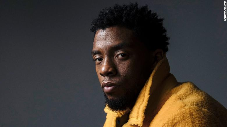 Chadwick Boseman in a yellow coat