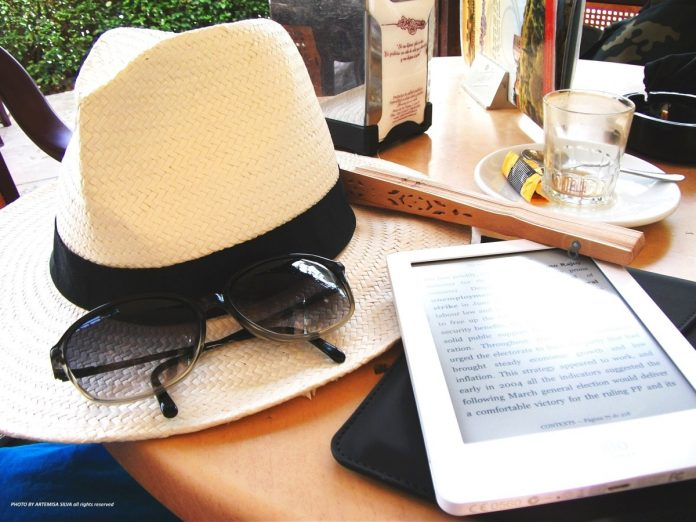 A hat, sunglasses and tablet
