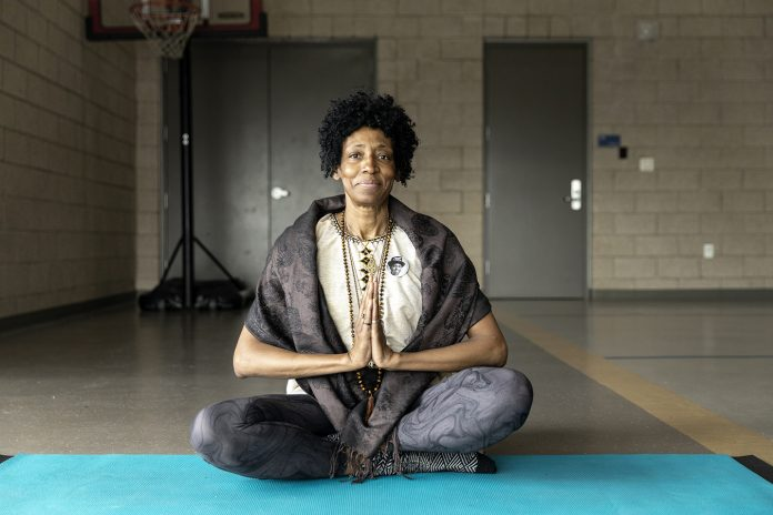 Woman sitting on the ground in a yoga position