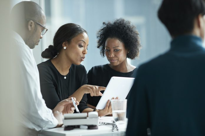 Two black women in the workplace