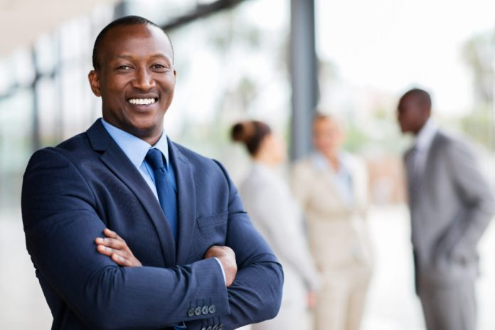 Black professional man in a suit smiling