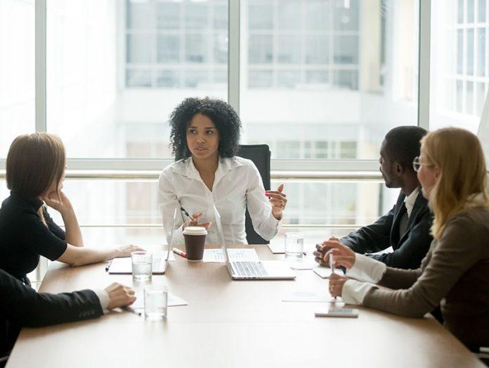 Black woman leading a meeting