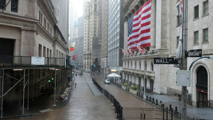 wall street buildings and a flag