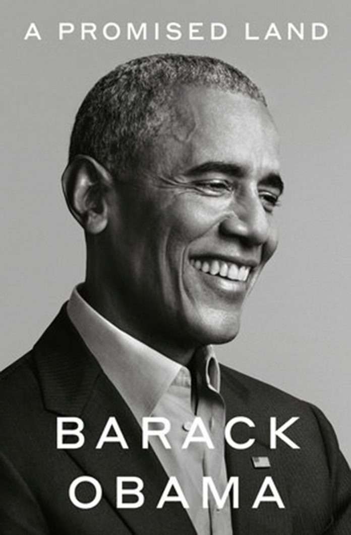 Barack Obama smiling on the cover of his new book