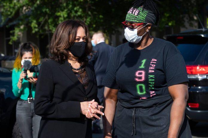 Kamala Harris speaking with a voter