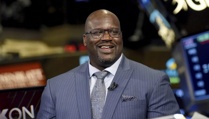 Shaquille O'Neal seated