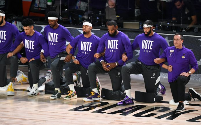 LeBron James and other players on the Los Angeles Lakers dressed in purple vote t-shirts