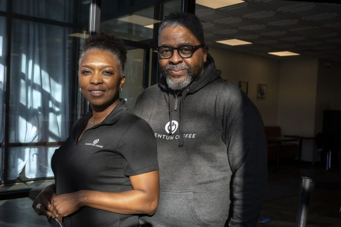Black couple posing wearing Black t-shirts