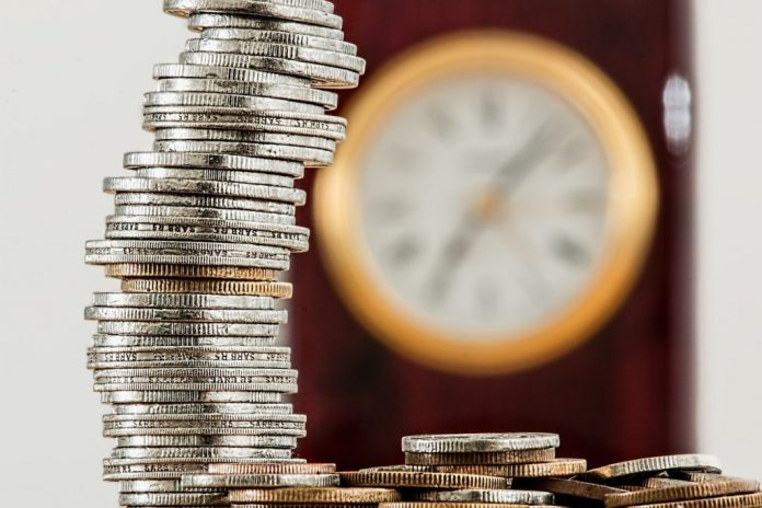 a clock and coins