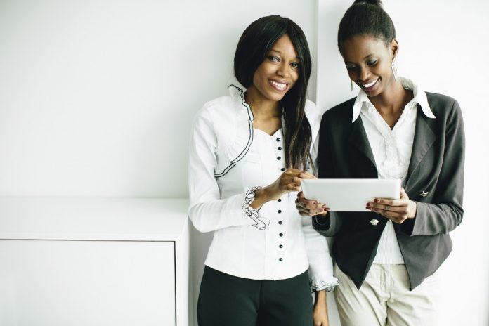 2 women side by side in an office